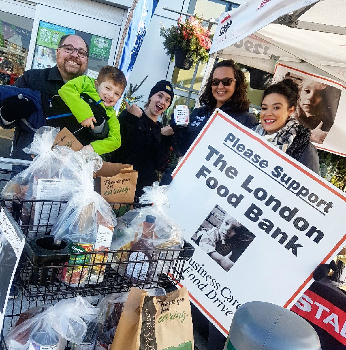 An image of volunteers at the Business Cares Food Drive's Grocery Store Weekend.
